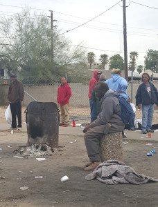 Homeless men sitting